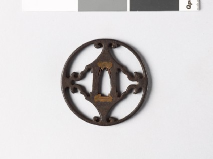 Round tsuba with voluted pointsfront