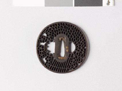 Round tsuba with a large faggot and plum blossomsfront