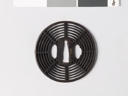 Round tsuba with cobweb designfront