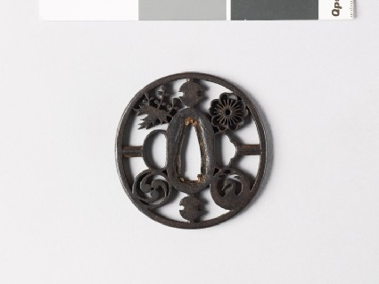 Tsuba with four mon and two fundō weightsfront