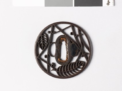 Round tsuba with oak leaves and pine needlesfront