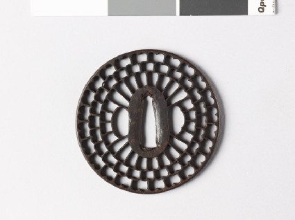 Round tsuba with radiating floral designfront