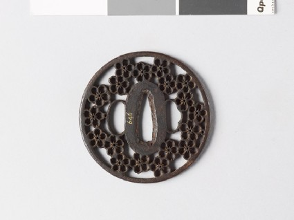 Round tsuba with plum and cherry blossomsfront