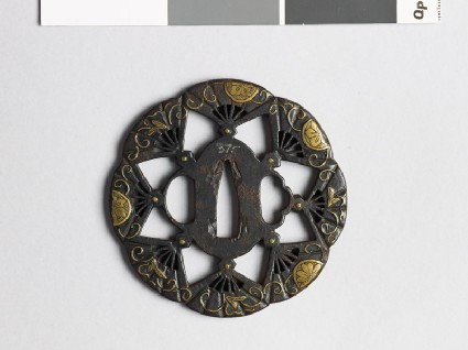 Lobed tsuba with flowers and fansfront