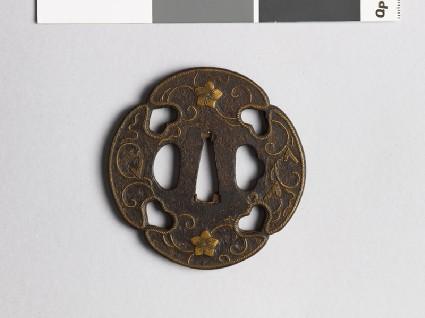 Mokkō-shaped tsuba with karakusa, scrolling floral patternfront