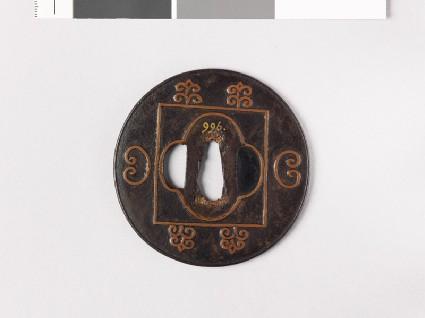 Lenticular tsuba with mokkō shape and C-scrollsfront