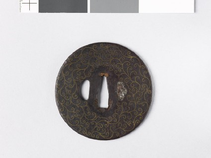 Round tsuba with scrolls and karigane, or flying geesefront