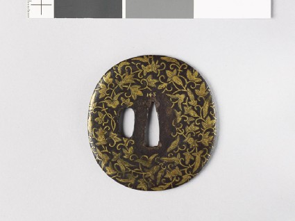 Lenticular tsuba with leaves and flowersfront