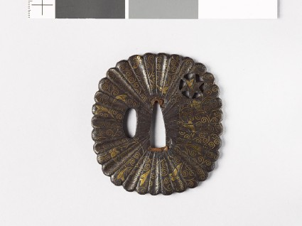 Tsuba with scrolling stems and heraldic clovesfront