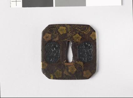 Square tsuba with karakusa, or scrolling floral patternfront