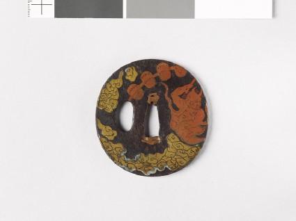 Round tsuba depicting Raiden, the god of thunderfront