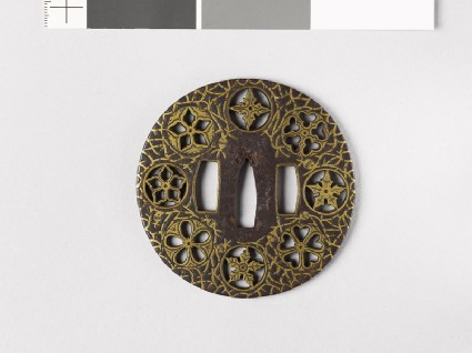 Round tsuba with flowers and water-weedsfront