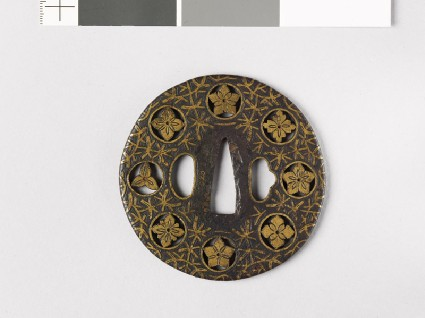 Round tsuba with flowers and water weedsfront