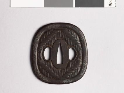Aori-shaped tsuba with zigzag mat patternfront