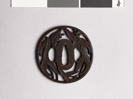 Tsuba with arrowhead leaves and flowersfront
