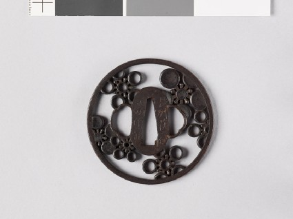 Round tsuba with mon crests of the Mayeda familyfront