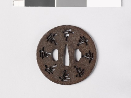 Tsuba with characters and flowersfront