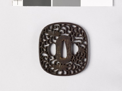 Tsuba with karakusa, or scrolling plant patternfront