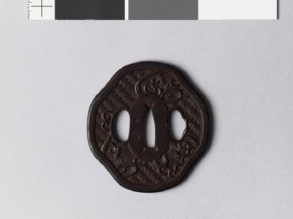 Mokkō-shaped tsuba with amariō, or rain dragonsfront