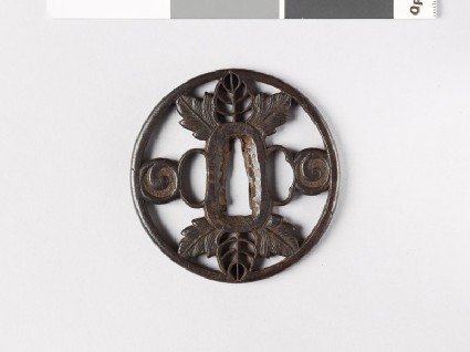 Tsuba with leaves and scrollsfront