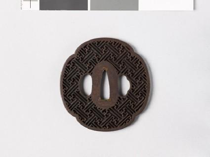 Mokkō-shaped tsuba with rinzu, or swastika-fret diaperfront