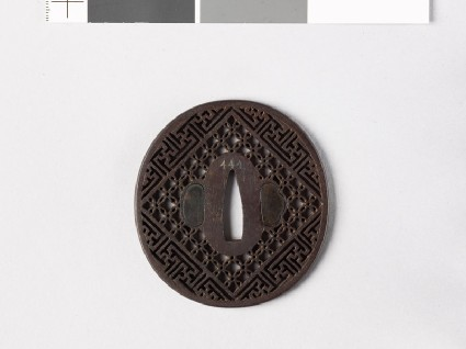 Tsuba with diaper formed from interlaced circles and swastikasfront