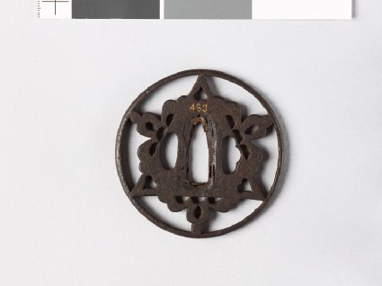 Round tsuba with triangle and flowersfront