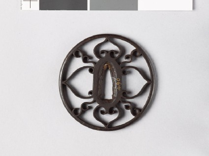 Round tsuba with scrolls and aoi, or hollyhock leavesfront