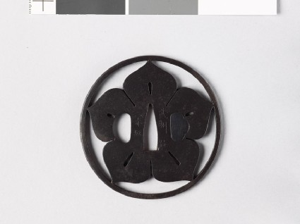 Tsuba with mon formed from a clematis flowerfront