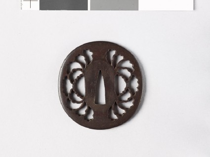 Lenticular tsuba with peony flowerfront