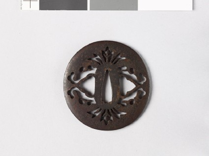 Lenticular tsuba with stylized flowersfront