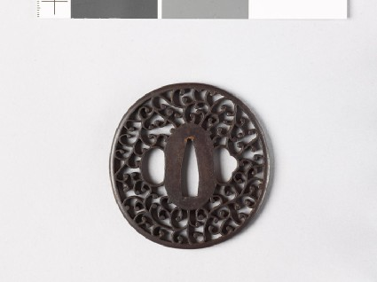 Tsuba with scrolling stemsfront