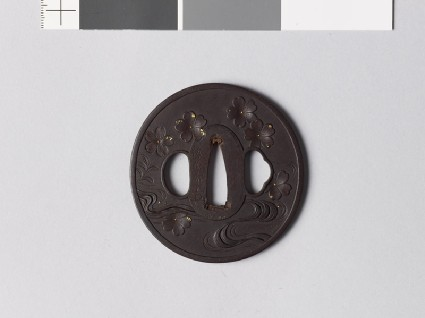 Tsuba with cherry blossoms falling towards a streamfront
