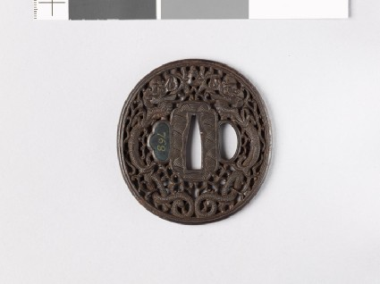 Tsuba with dragons and karakusa, or scrolling plant patternfront
