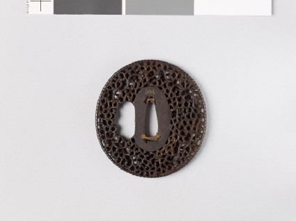 Tsuba with scrollworkfront