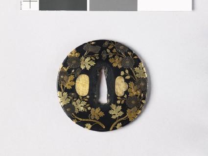 Tsuba with chrysanthemumsfront