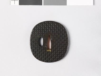 Lenticular tsuba with hanawachigai, or interlaced circles enclosing karahanafront