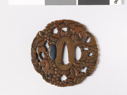 Mokkō-shaped tsuba with vine and squirrelsfront