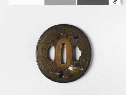 Lenticular tsuba with tea ceremony utensilsfront