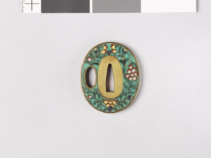 Tsuba with flowers, clouds, and karakusa, or scrolling plant patternfront