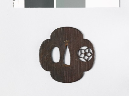 Mokkō-shaped tsuba with mon formed of a clematis flower in a circlefront