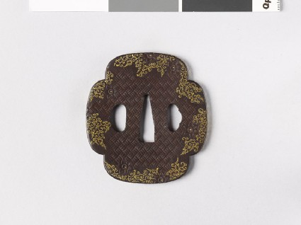 Mokkō-shaped tsuba with clematis flowers and karakusa, or scrolling plant patternfront