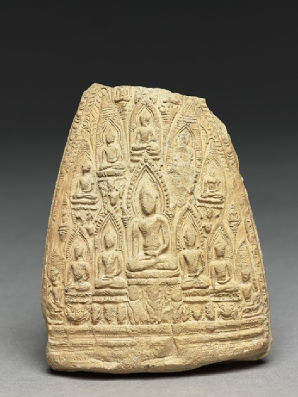 Votive plaque of the seated Buddha with attendant Buddhasfront