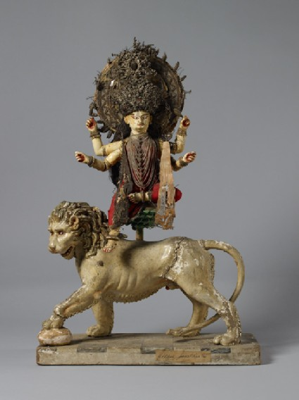 Figure of Durga Mahishasuramardini sitting on a lotus on the back of her lionfront