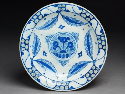 Dish with central medallion and leavestop