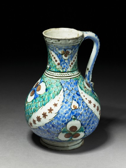 Jug with leaves and çintamani motif against a fish-scale backgroundoblique