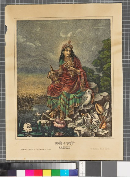 Lakshmi seated by a pool with an owlfront