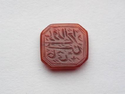 Octagonal bezel seal with nasta'liq inscription, chevron decoration, and a starfront