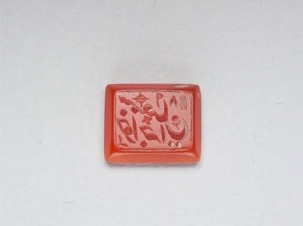 Rectangular bezel seal with nasta'liq inscription, chevrons, and floral decorationfront
