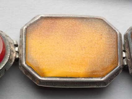 Octagonal bezel amulet with thuluth inscription, from a braceletfront